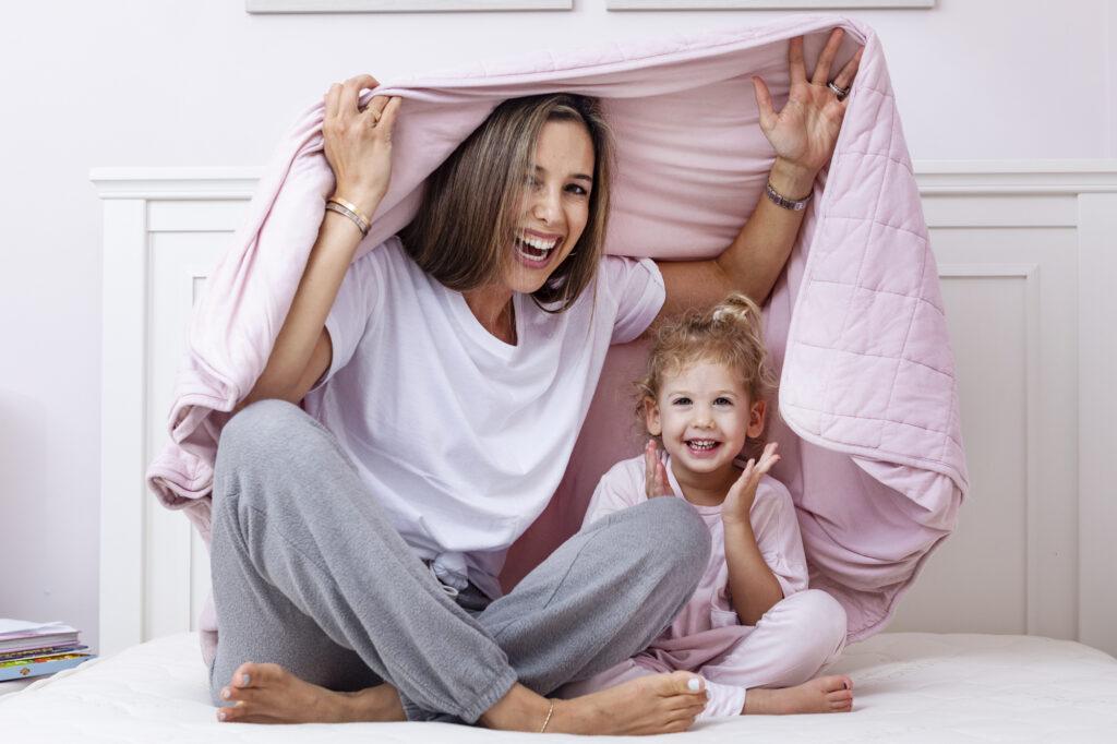 under blanket on mattress